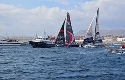 Clean Seas And Scallywag Sailing Very Close Between Spectator Boats Volvo Ocean Race Alicante 2017. Very close sailing between the many spectator boats in Stock Photos