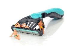 Clean shaven miniature figures Stock Photo
