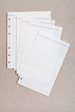 Clean sheet of lined notebook. On a gray cardboard Royalty Free Stock Photos