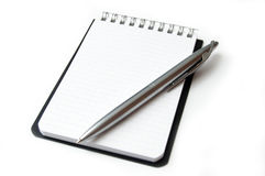 Clean sheet of notebook isolated on white. Stock Photo