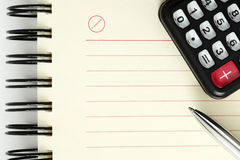 Clean sheet of notebook with pen and calculator Royalty Free Stock Photography