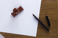 Clean sheet of paper and a pen wooden stamp Royalty Free Stock Images