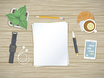 Clean sheets of paper on the desktop. Top view Preparation for work, notes, sketches. Royalty Free Stock Photos