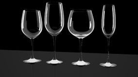 Diferrent wine glasses on shiny a desk. stock photography