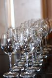 Clean shiny wine glasses stand in a row stock image