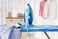 Clean shirt and iron on board. Indoors royalty free stock photography