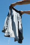 Clean shirt. Wet shirt against blue sky royalty free stock image