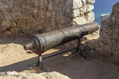 Clean shoot of old iron made black cannonball in the castle stock photography