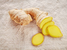 Clean Sliced Ginger on White Cloth Royalty Free Stock Image
