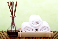 Clean spa towels and essential oil Royalty Free Stock Images