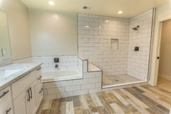 Clean Spacious Master Bedroom Bathroom With Shower And Tub And Wood Floors In San Diego California Stock Photography