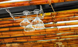 Clean stemware hanging on the rack in the bar Royalty Free Stock Photo