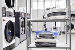 Clean stuff is on the rack. At the dry cleaners Royalty Free Stock Photos