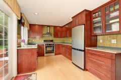 Clean style kitchen with stained wood. Royalty Free Stock Photos