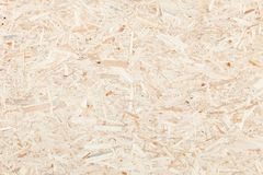 Clean surface of wood particle Board. Texture of compressed wood chippings board. Clean, light surface of wood particle Board. Texture of compressed wood stock image