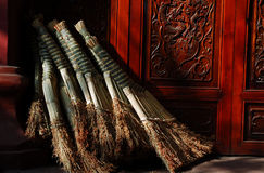 Clean sweep. Some new clean sweep in front of the door of a temple Stock Image