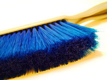 Clean Sweep. Close up of blue cleaning brush Stock Photos