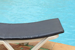 Clean swimming pool and resting chair Stock Images
