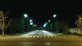 Clean and symmetrical streets.night scene. streat lamp. Clean and symmetrical streets.night scene.zebra crossing. An empty streets stock photography