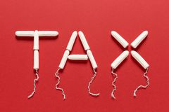 Clean Tampons Forming the Word TAX on a Red Background Stock Images