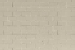 Clean tan generic brick cinder block wall background Royalty Free Stock Photo