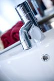 Clean tap of modern washbasin Royalty Free Stock Photos