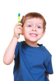 Clean teeth. Five years old boy brushing teeth isolated on white stock photos