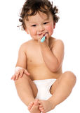 Clean teeth. The child study to clean a teeth Royalty Free Stock Photography