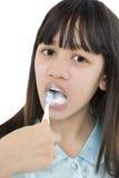 Clean teeth. Girls cleans the teeth carefully Royalty Free Stock Photos