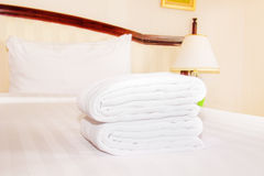 Clean towel  on the bed Stock Photography