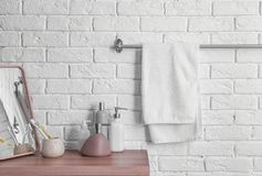 Clean towel on rack. In bathroom stock image