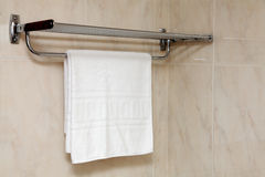 Clean towel. Clean white towel on the rack Stock Photography