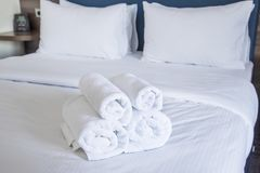 Clean towels on bed. Selected focus. stock photos
