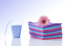 Clean towels with a flower isolated on white Stock Photo