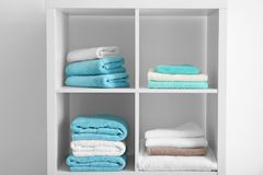 Clean towels on shelves. In bathroom Royalty Free Stock Photos