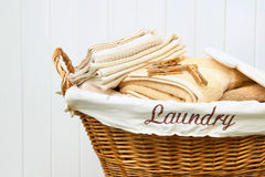 Clean towels in wicker basket royalty free stock photography