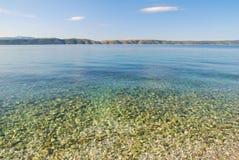 Clean Transparent Blue Sea Royalty Free Stock Photos