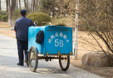 Clean tricycle. An old man pushing a tricycle conduct environmental work,This photo was taken on March 9, 2014 Stock Image