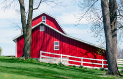 Clean trim barn in Michigan USA. A beautiful red barn stands out, all clean and trim, on a hilltop in MIchigan USA royalty free stock photo