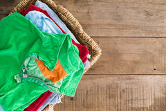 Clean unironed summer clothes in a laundry basket Royalty Free Stock Photography