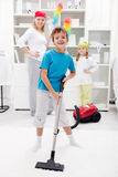 Clean up day. Kids helping their mom doing chores