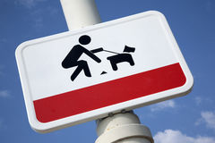 Clean Up Dog Litter Sign. Against Blue Sky Background Stock Photography