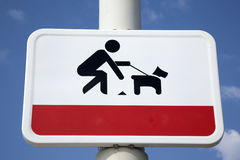 Clean Up Dog Litter Sign. Against Blue Sky Background Royalty Free Stock Images