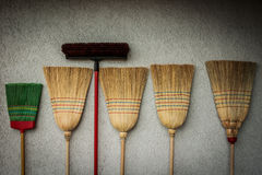Clean up gear-handmade brooms. Cleaning gear consisting of different types of brooms Stock Photos