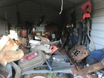 Junk filled garage. Clean-up is needed Royalty Free Stock Photography