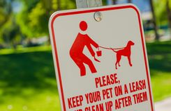 Clean Up After Pet Sign. Please Keep Your Pet on Leash and Clean Up After Them. Park Sign Stock Photos