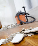 Clean-up time. View from plaster pieces on a hardwood floor. Vacuum in background Stock Images