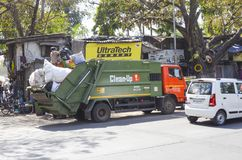 Clean-Up! Trash collecting service truck, Mumbai, India. Collecting trash from local neighbourhoods stock photography