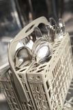 Clean Utensils in Dishwasher Stock Image