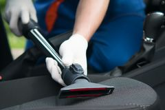Clean and vacuum the car seats, close-up royalty free stock image